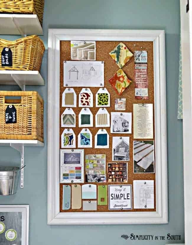Bulletin board that covers the fuse box-This small laundry room is big on organization ideas! Using baskets, bins, shelves along with hidden storage makes this 28 sq ft laundry room super organized and stylish.