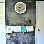 Chalkboard wall and art display. Boy's shared bedroom by Simplicity In The South.