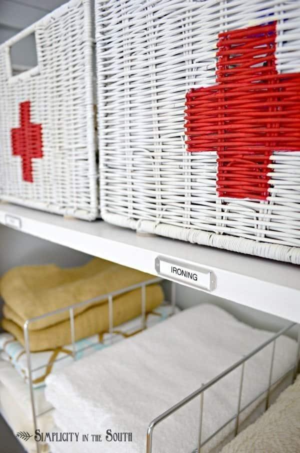 Linen closet organization ideas. Labeled shelves and Swiss army baskets.