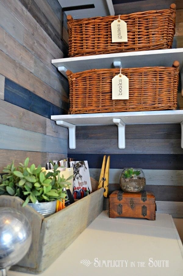 organized office in a closet with baskets