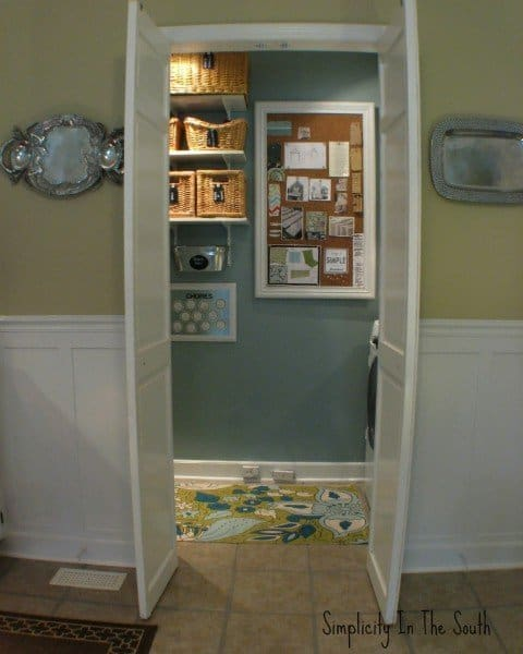 laundry room with cork board that covers the fuse box