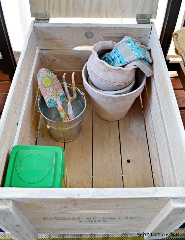 DIY wooden crate storage table. Repurpose a wooden crate into a rolling side table. Just add a lid, a handle, caster wheels and some paint.