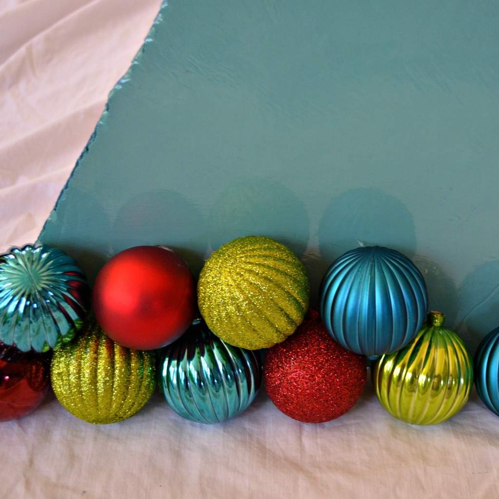 Once The Paint Dried, I Propped Up The Board And Began Hot Gluing The  Ornaments