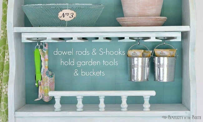 Dowel rods and s-hooks hold garden tools and buckets