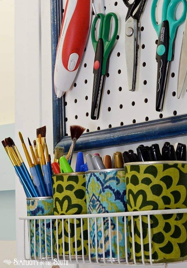 Fabric covered tin cans for storing craft supplies. Craft closet organization tips: Part of the small home, big ideas series, find out how to organize your craft supplies