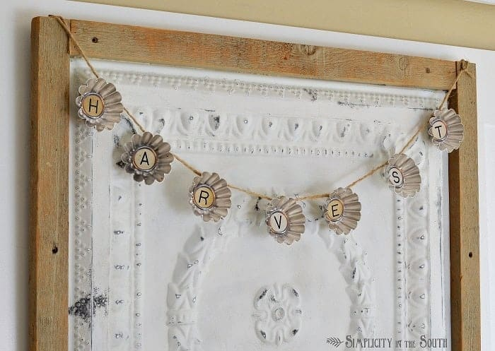 Fall garland made from vintage tart tins and printable typewriter letters.
