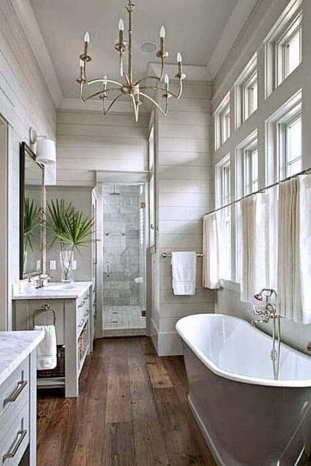 Neutral transitional master bathroom with clawfoot tub