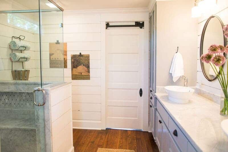 White shiplap bathroom from Fixer Upper with glass shower enclosure
