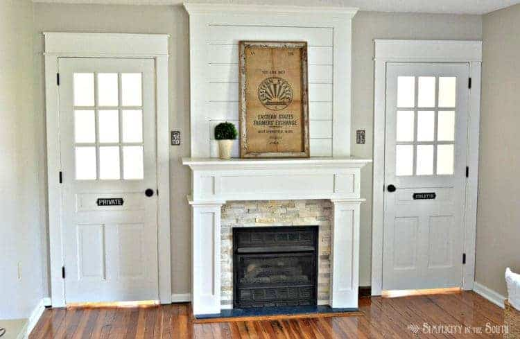 Beautiful fireplace surround with ledgestone and shiplap