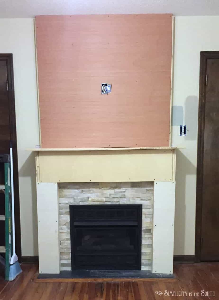 diy budget fireplace surround from the boring brown before to a - How To Build A Fireplace Surround