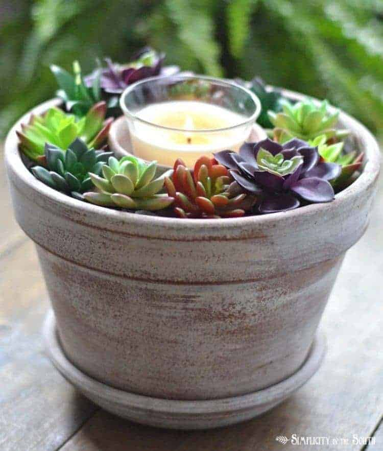 A simple and affordable faux succulent candle centerpiece that takes less than 10 minutes to make. Most supplies can be purchased at The Dollar Tree.
