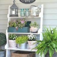 ideas for decorating a porch for spring or summer with a shelf to place pots with flowers and decor
