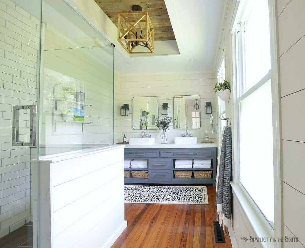 A bedroom is turned into a modern farmhouse style master bathroom on a budget