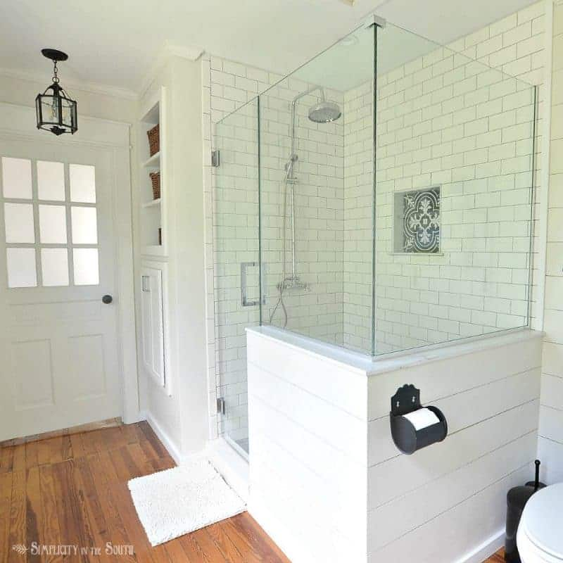 A Modern Farmhouse Style Bathroom Remodel With Glass Shower Enclosure And Fre