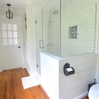 Master bathroom remodel with glass shower enclosure and pony wall