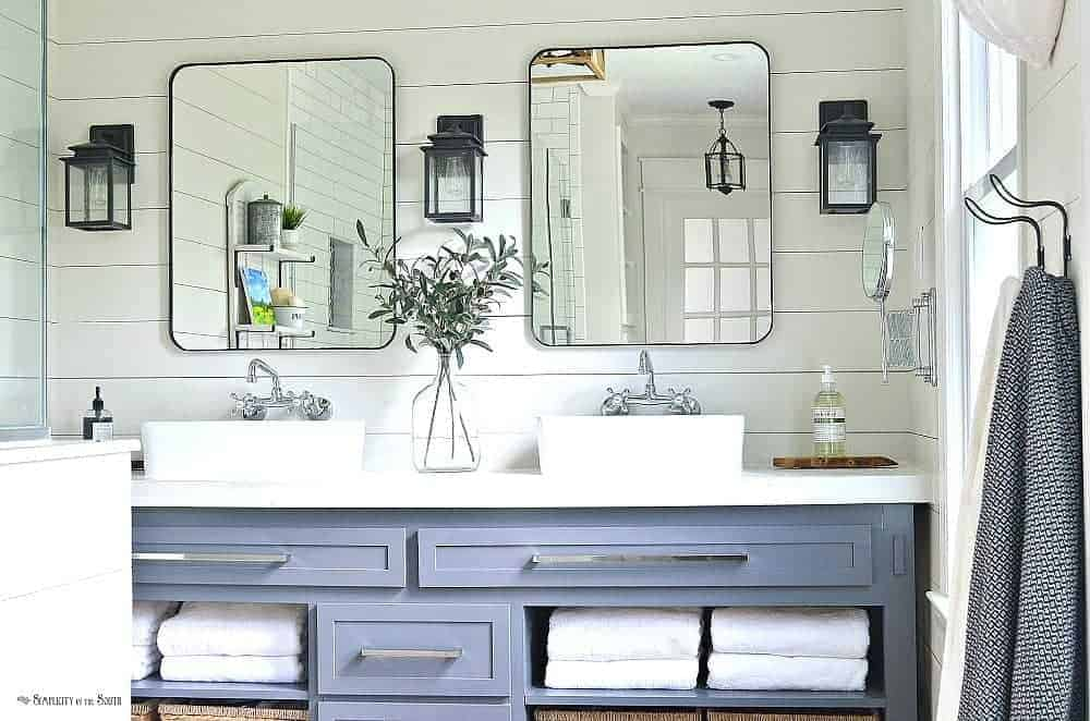 Modern farmhouse bathroom remodel with shiplap walls and Restoration Hardware knock off mirrors