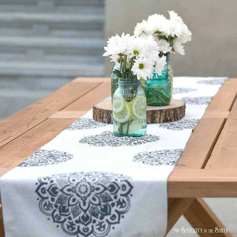 DIY stenciled mandala table runner made from a drop cloth