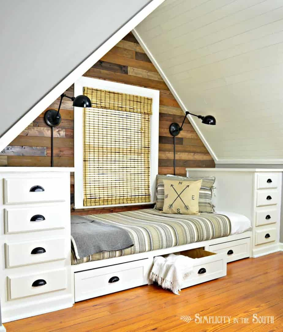 Cozy built in bed with trundle drawers using kitchen cabinets on each side as the dressers.