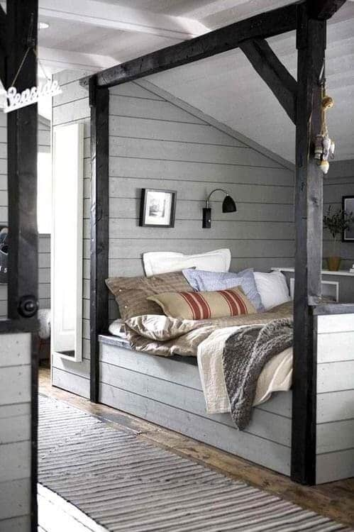 Cozy built-in bed with grainsack pillow