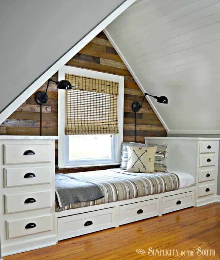 Cozy built in bed with tons of storage! Love the planked wall treatment
