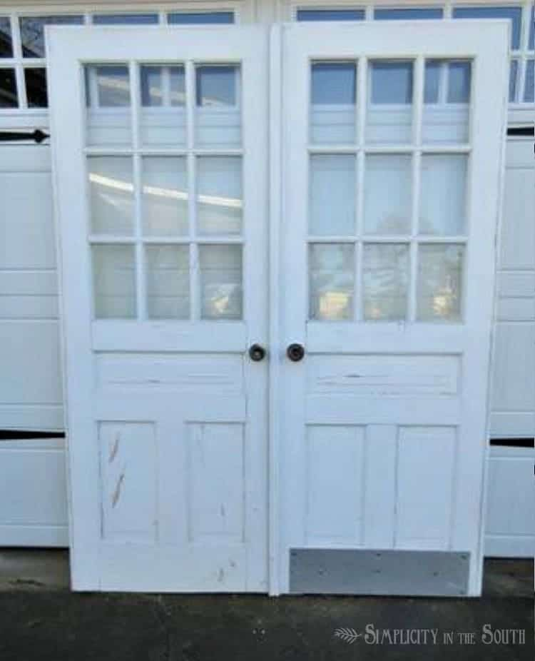 These salvaged church doors will replace the hollow core doors in the master bedroom