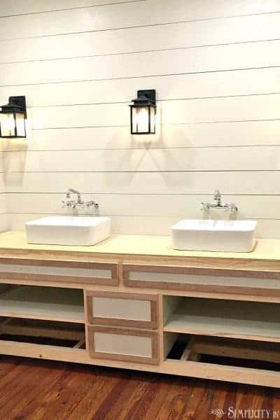 Eclectic farmhouse bathroom - new vanity in progress, lighting, vessel sinks and wall faucets