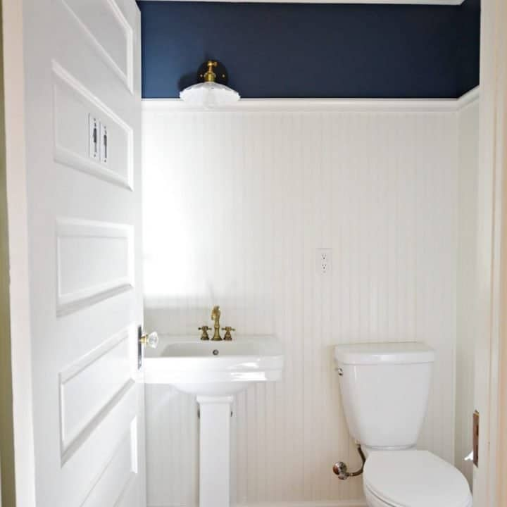 half bathroom with beadboard and faux tin ceiling