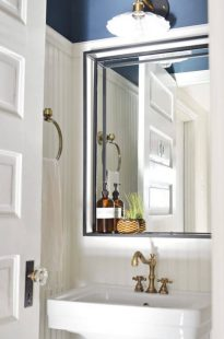 Navy and white vintage modern powder room remodel