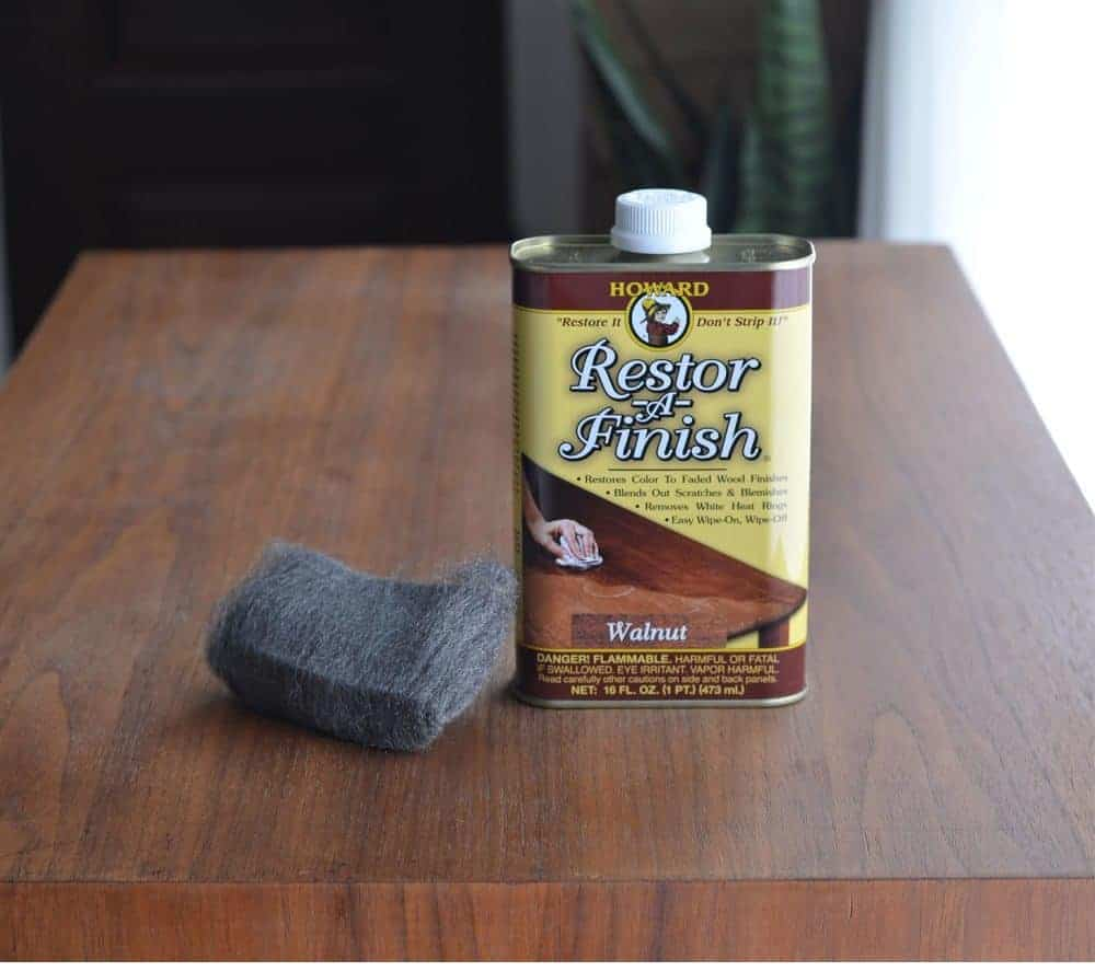 using Howards Restor-A-Finish to revitalize damaged wood table top