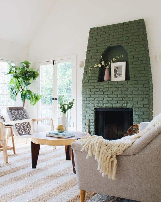 neutral living room with green painted brick fireplace by The Platform Experiment on Instagram