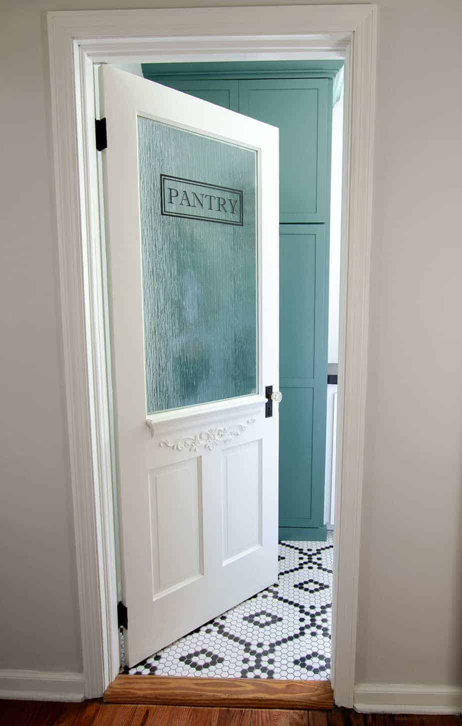 farmhouse pantry door with glass and Sherwin Williams Studio Blue cabinet