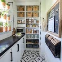 narrow walk in pantry design with countertop and shelving